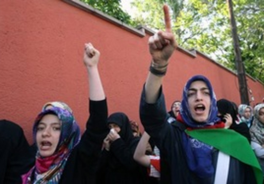 Pro-Palestinian Turkish protesters shout slogans ""