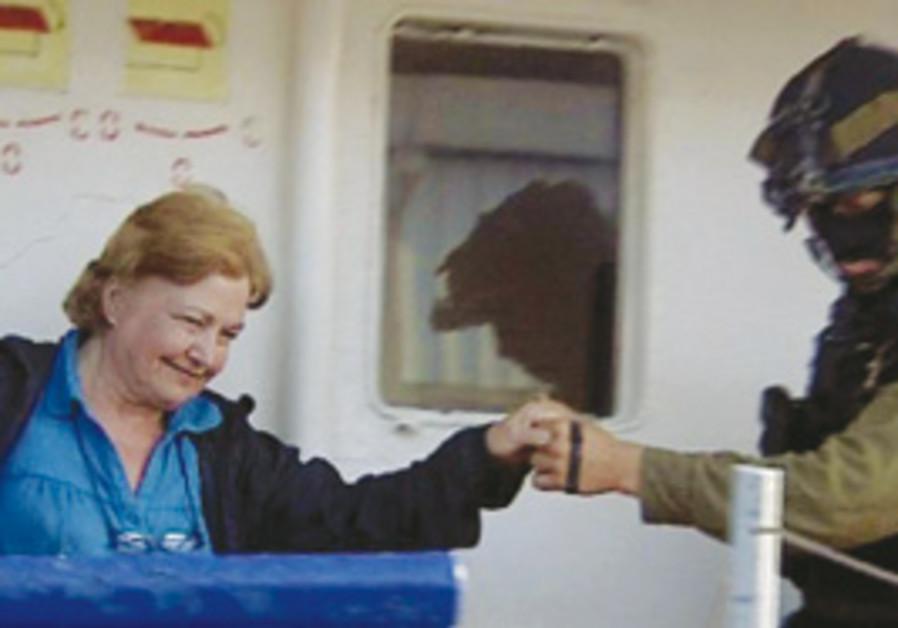 A Soldier helps Nobel Peace Prize laureate Mairead