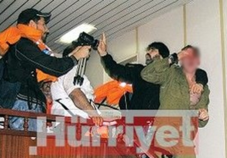 Censored images of Shayetet soldiers beaten.