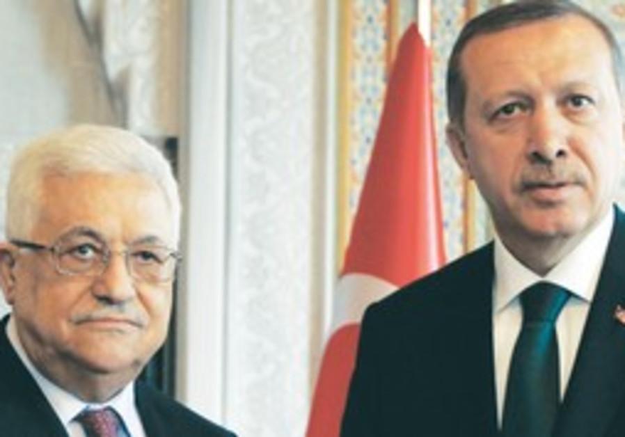 PA PRESIDENT Mahmoud Abbas stands with Turkish Pri