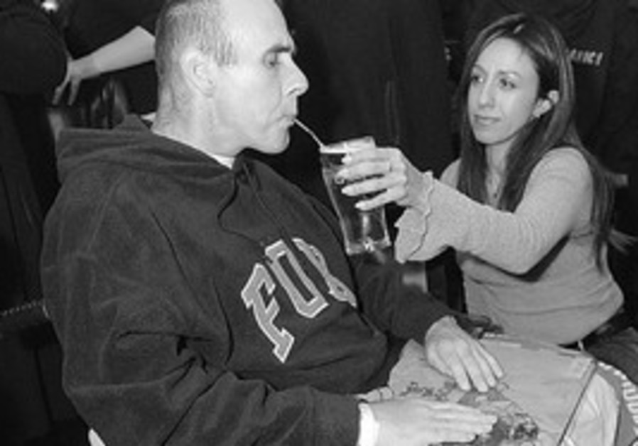 STEVE AVERBACH enjoys a beer served by his wife, J