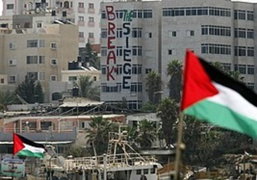Palestinian flags atop fishing boats belonging to
