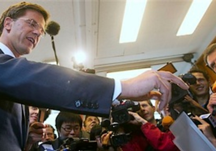 Conservative VVD party leader Mark Rutte casts his