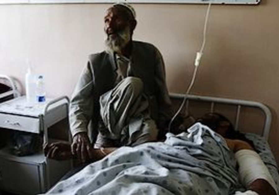 An unidentified father comforts his injured son at