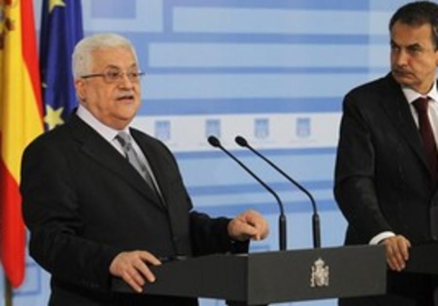 Palestinian President Mahmoud Abbas, left, speaks