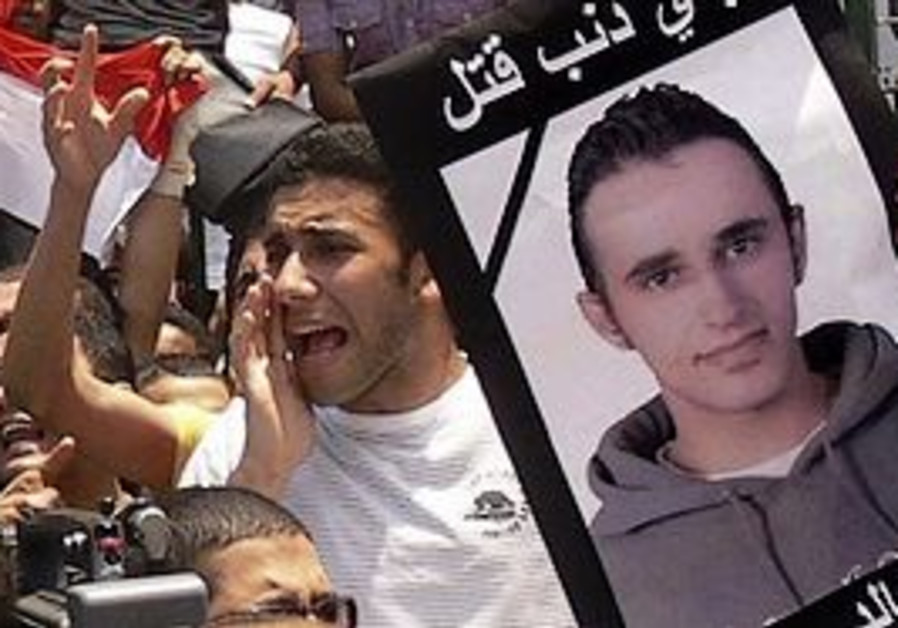 Egypt cafe owner describes police beating death PA