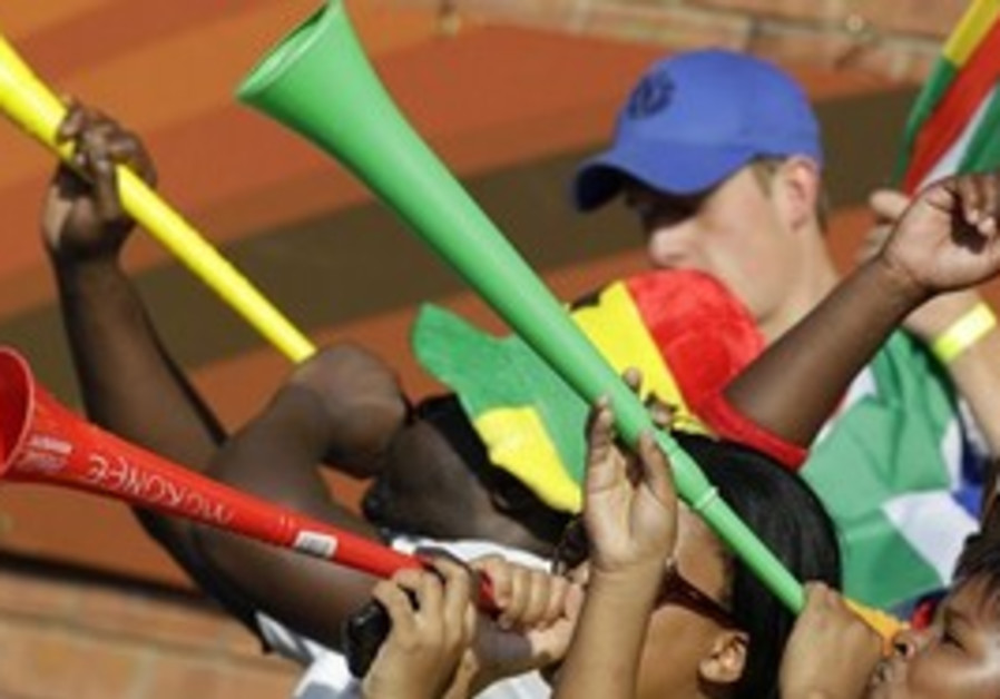 Fans play their vuvuzelas prior to the World Cup g
