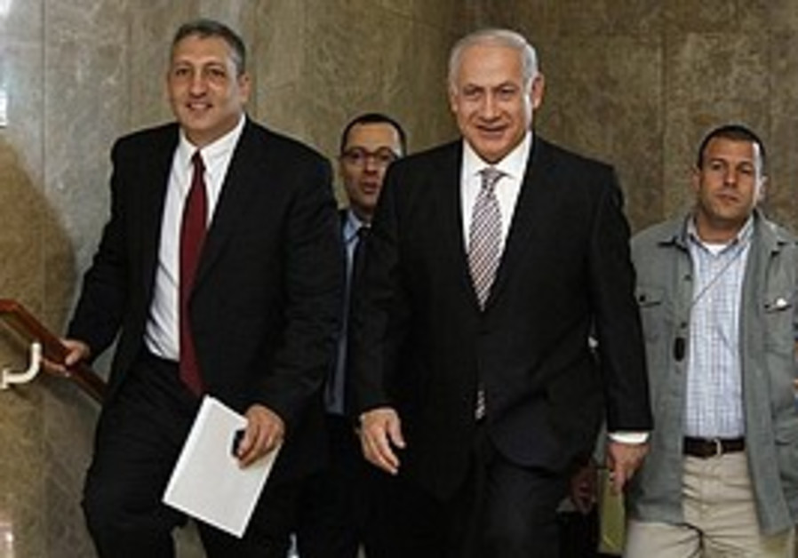 Netanyahu arrives at Monday's cabinet meeting in J