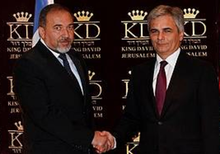 FOREIGN MINISTER Avigdor Lieberman shakes hands wi