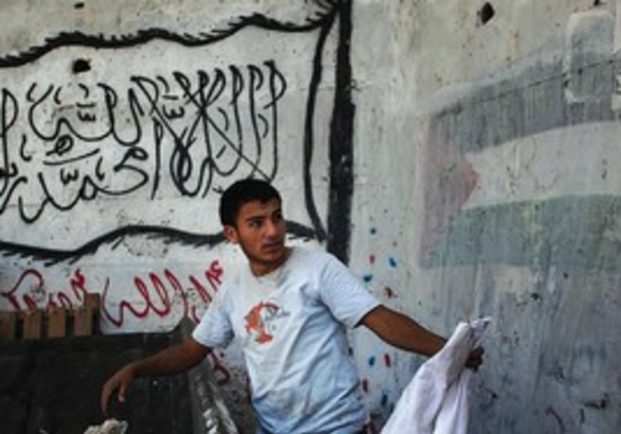 A PALESTINIAN youth in the east Jerusalem neighbor