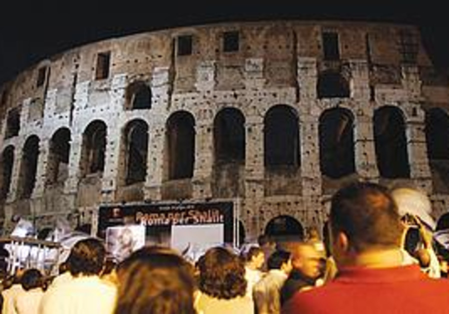 PEOPLE GATHER outside a darkened Colosseum on Thur