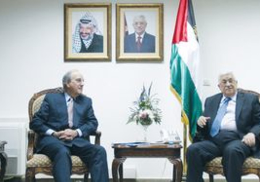 US MIDEAST envoy George Mitchell, left, sits with