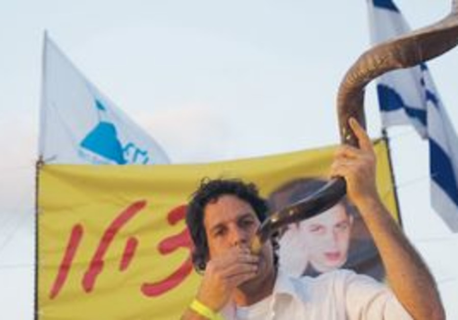 A MAN blows a shofar before the Shabbat eve prayer