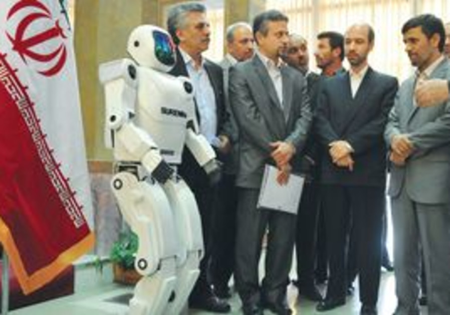 Ahmadinejad playing with a robot