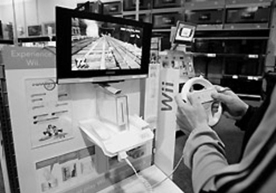 A customer plays a game on a Nintendo Wii at Best