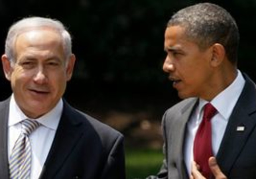 President Barack Obama walk with Israeli Prime Min