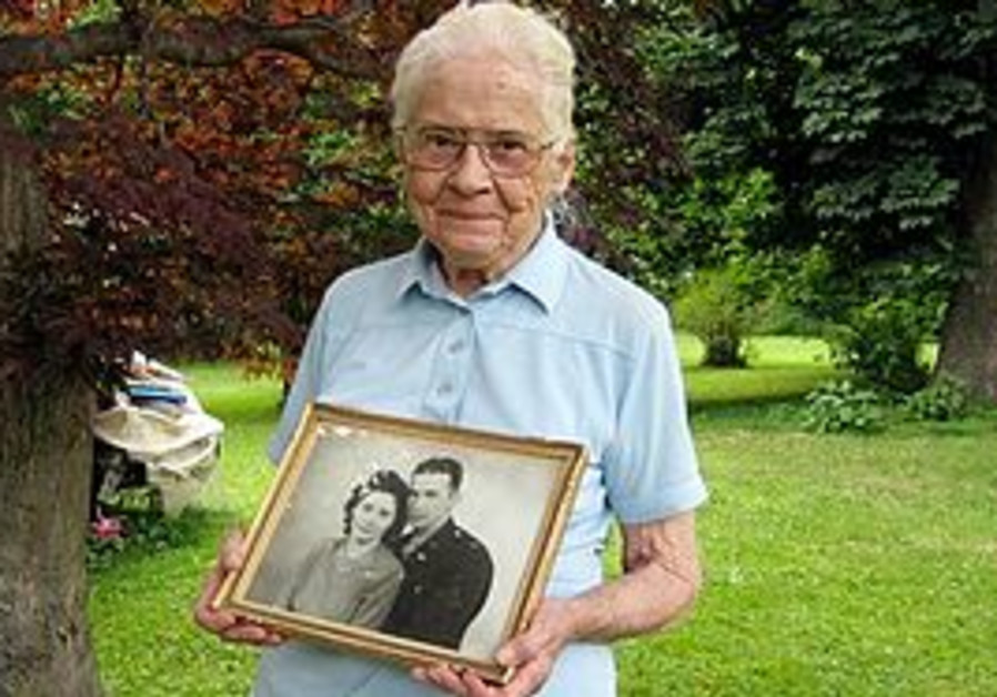 Jean Stevens with a photo of her and her deceased