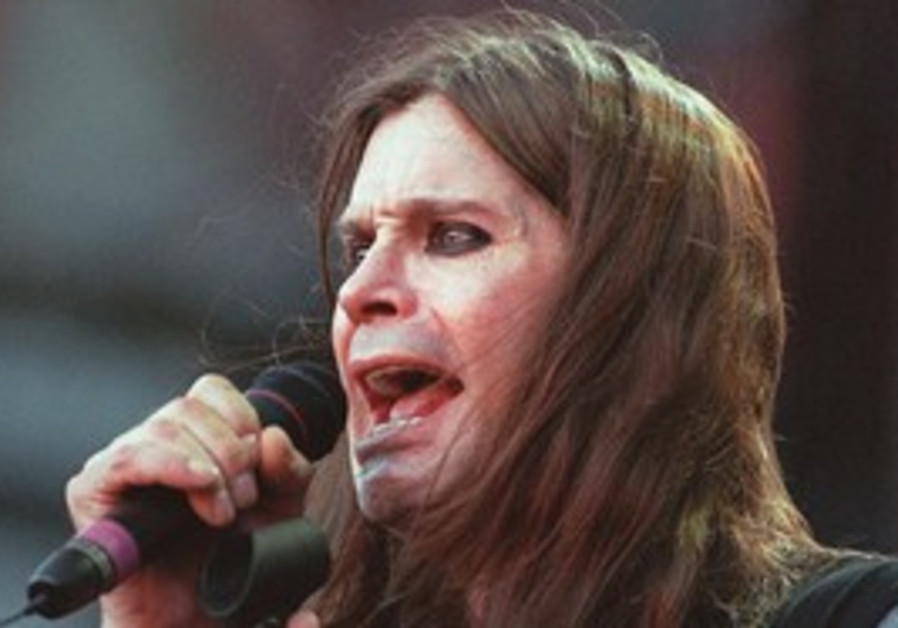 Ozzy Osbourne performs with Black Sabbath during t