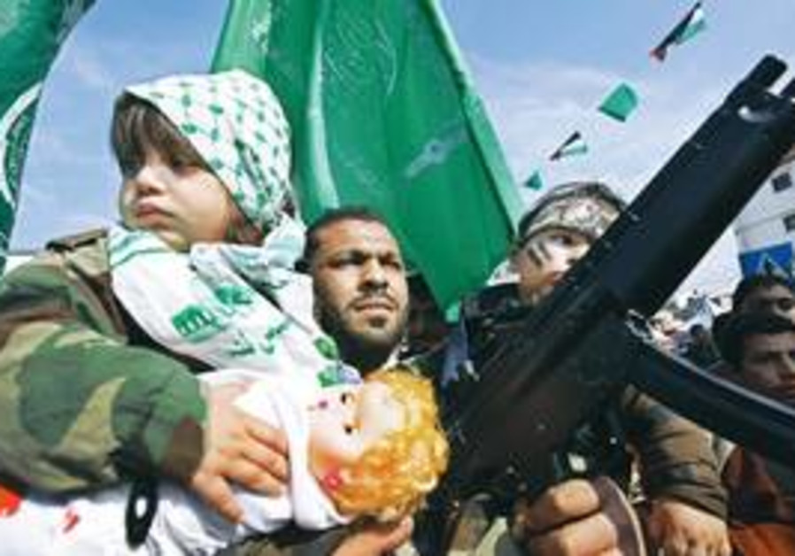 A HAMAS man and his children, one clutching a mart