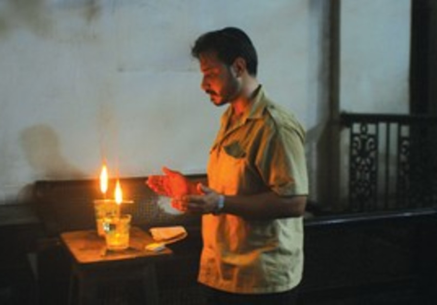 DEVOTION: Shalom Israel lights a candle and prays