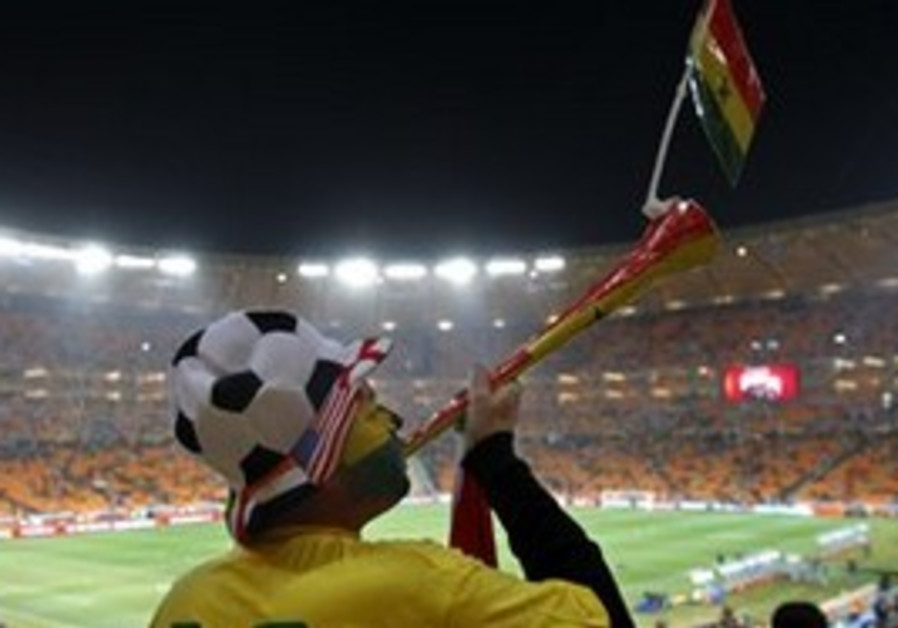 A Ghana fan blows a vuvuzela prior to the World Cu