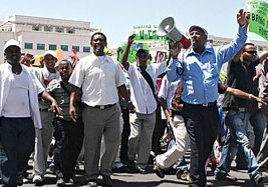UNITED WE stand. 'Ethiopian Jews in Israel are und