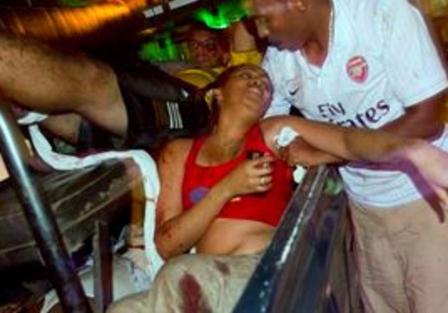 A man attends a injured women , Sunday, July 11, 2