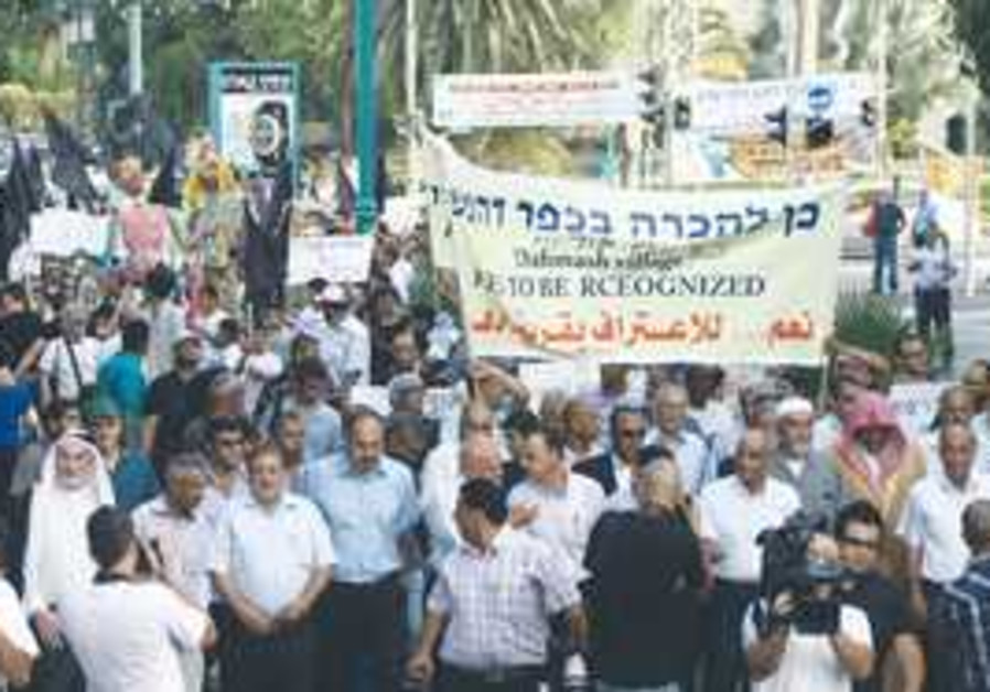MARCHERS HEAD OUT from central Ramle to protest th