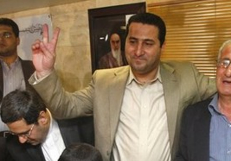 Shahram Amiri, center, an Iranian nuclear scientis