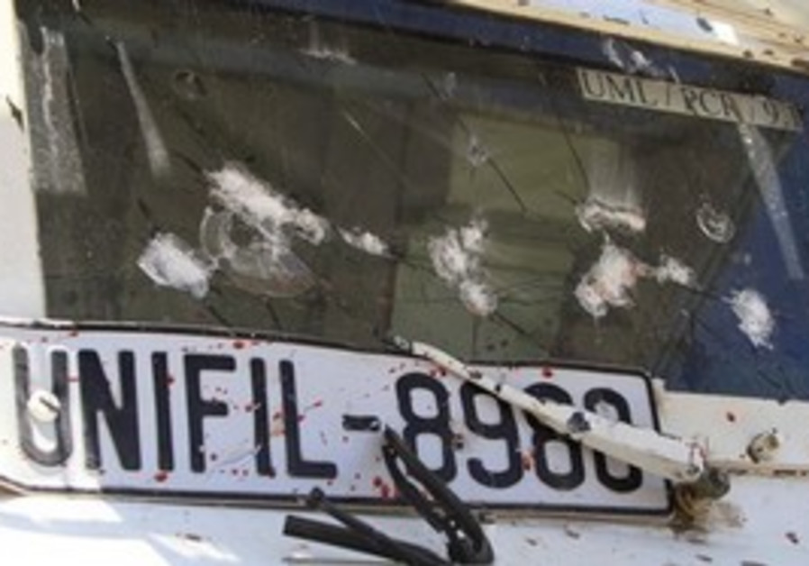 A damaged armored vehicle of the French UN peacekeepers, is seen with blood, in Touline village, sou