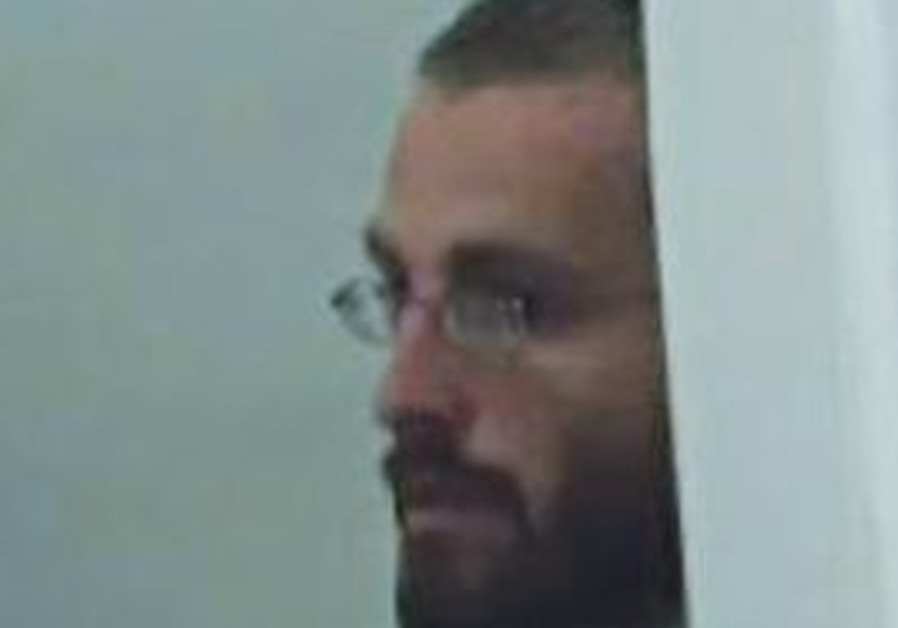 HAIM PEARLMAN, in court yesterday. The suspect claims he was encouraged by a Shin Bet agent posing a
