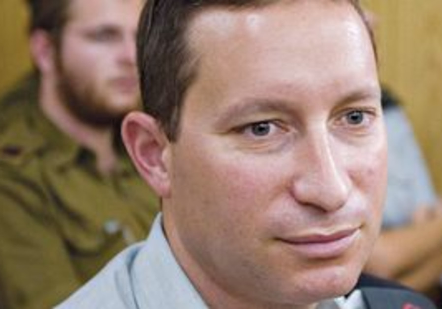 LT.-COL. Omri Burbag sits yesterday in a Tel Aviv military court, which convicted him and one of his