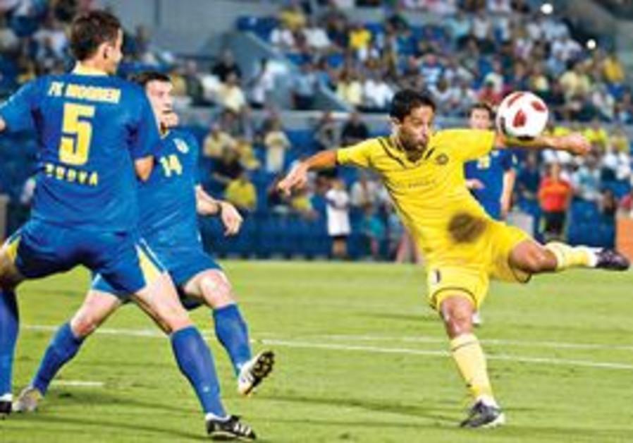 MACCABI TEL AVIV striker Barak Itzhaki attempts a volley during his team's 2-0 victory over FK Mogre