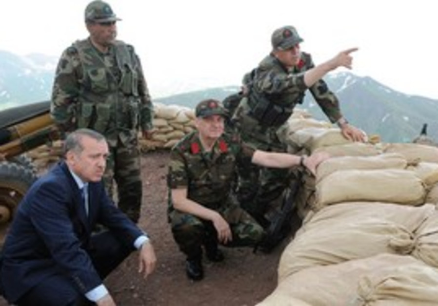 POLITICAL CONCERNS and regional ambitions. Prime Minister Erdogan, seen here getting a briefing on t