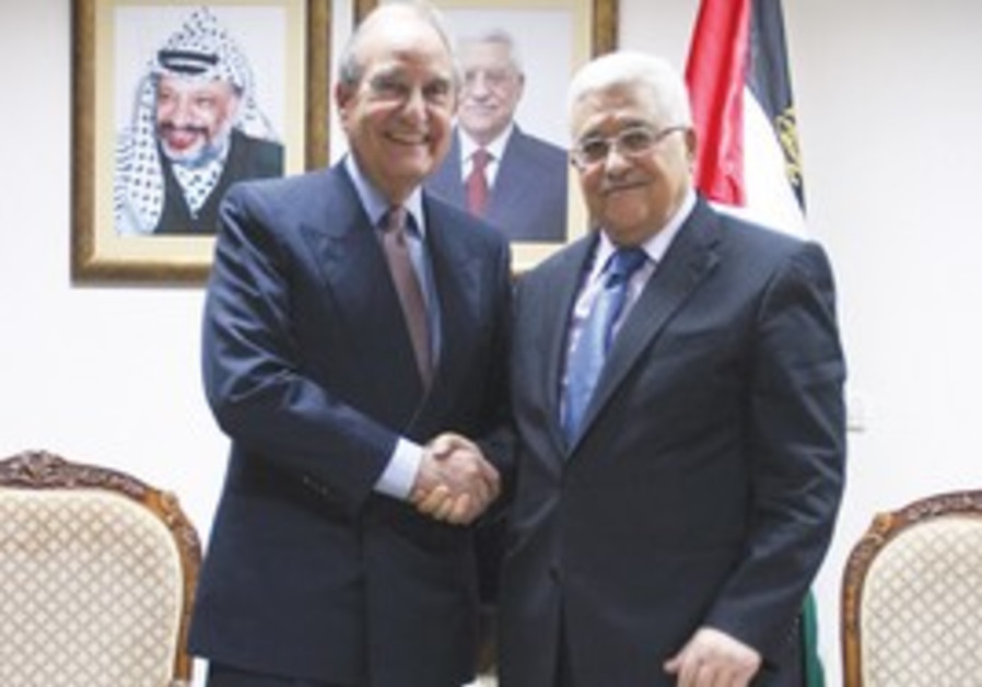 GEORGE MITCHELL (left) meets Mahmoud Abbas in Ramallah yesterday.