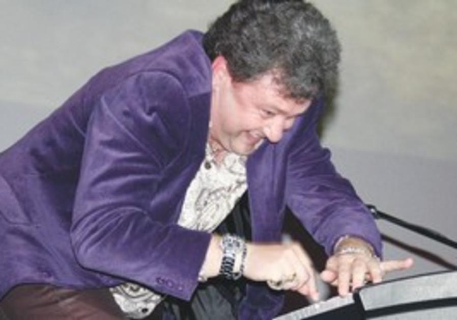 LEONID PTASHKA jams on keyboard at a previous Limmud conference.
