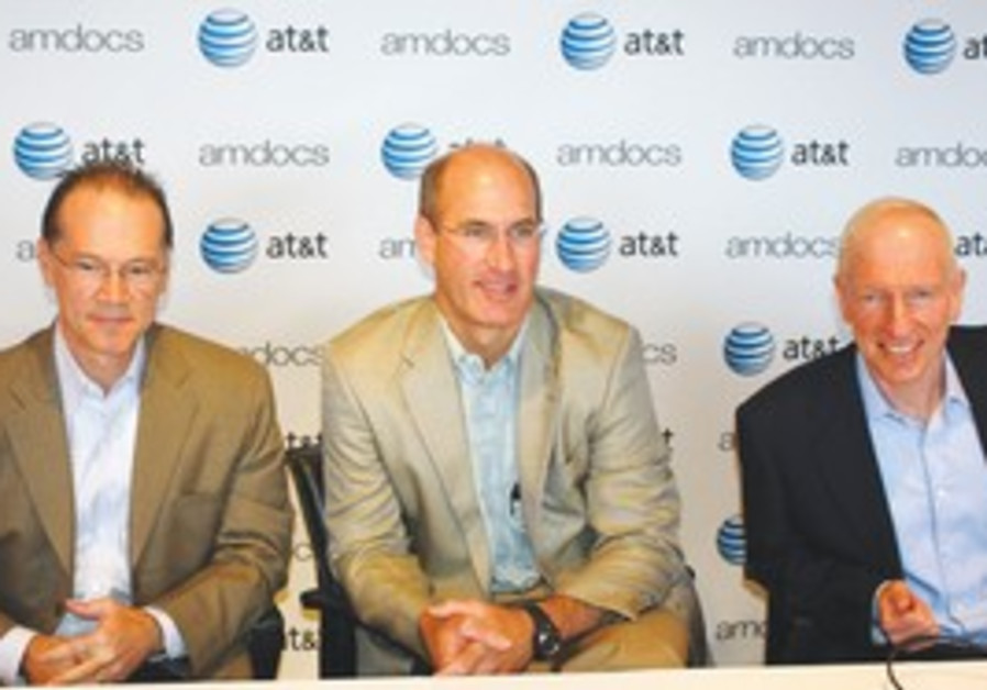 FROM LEFT: AT&T's chief technology officer John Donovan and CEO of operations John T. Stankey attend