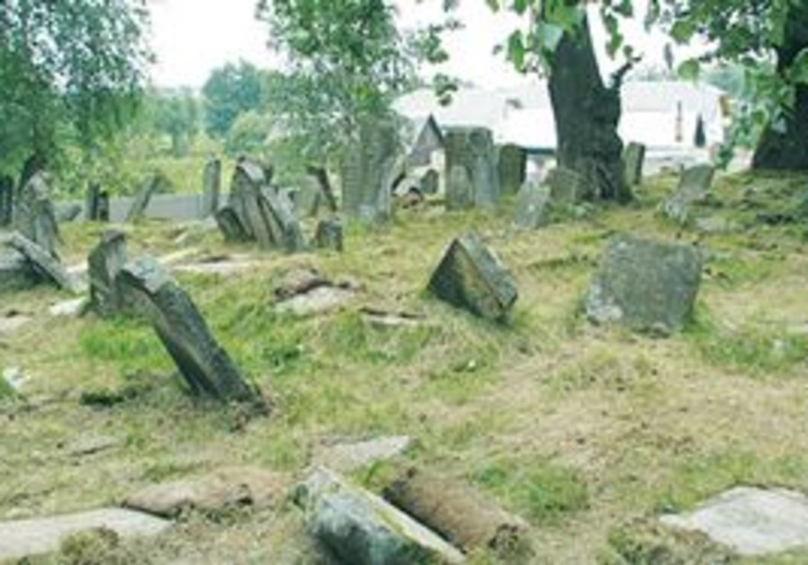 TOMBSTONES IN the neglected Jewish cemetery of Bolechow in the Ukrainian part of Galicia.