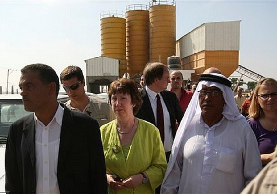 European Union Foreign Policy Chief Catherine Ashton, center, visits a cement factory in east of Jab