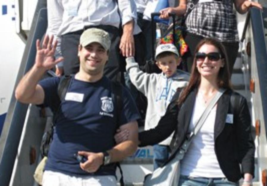 YOSEF 'JOE' Serkin, 28, and his wife Yonit, 27, disembark from a Nefesh B'Nefesh charter flight at B