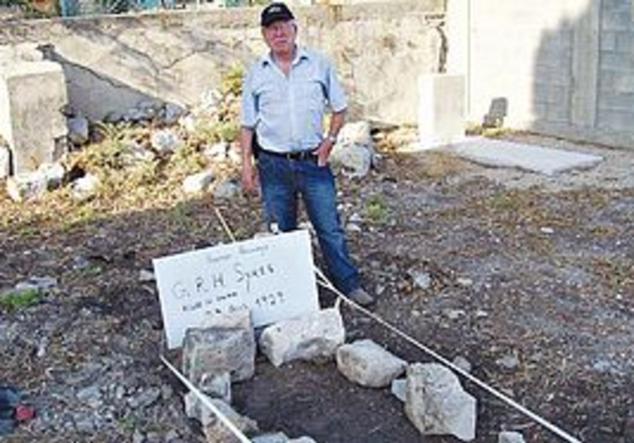 MICHAEL GOTTSCHALK stands at the gravesite of George R. Hughenden Sykes, whose headstone was apparen