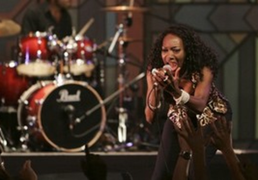 Maizie Williams sings with her band Boney M, during a concert in Ramallah, Tuesday.