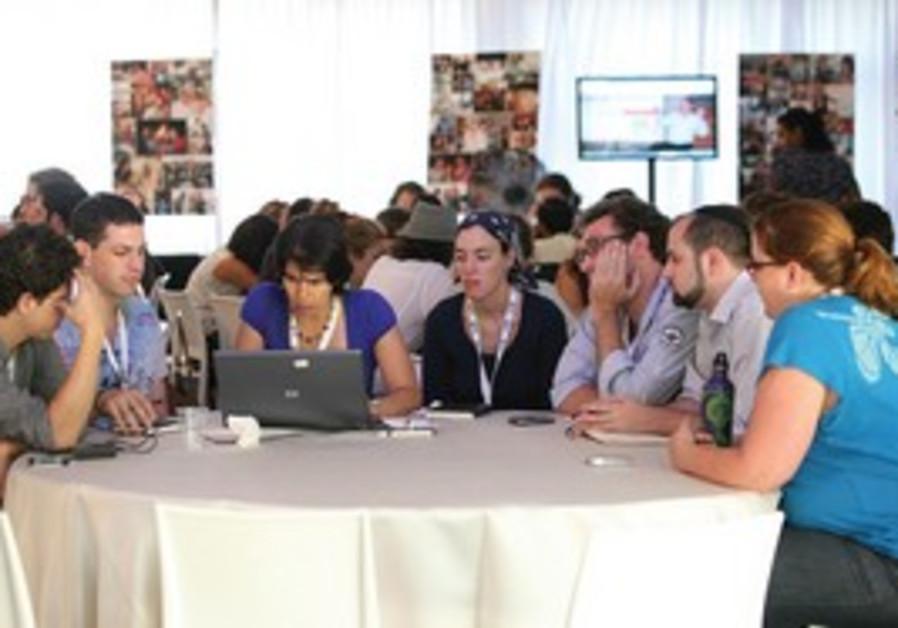 ROI SUMMIT participants at a 'community brainstorm' session.