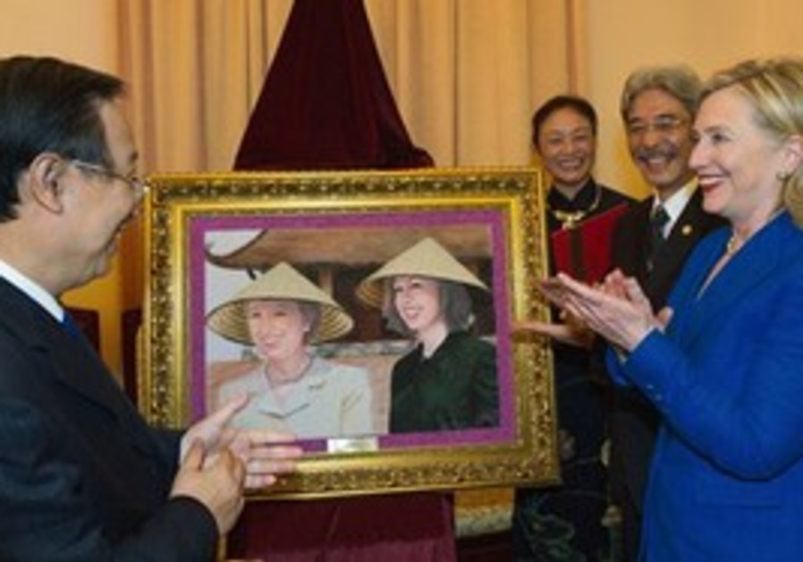 Secretary of State Clinton receives a present for her daughter's wedding on her visit to Vietnam.