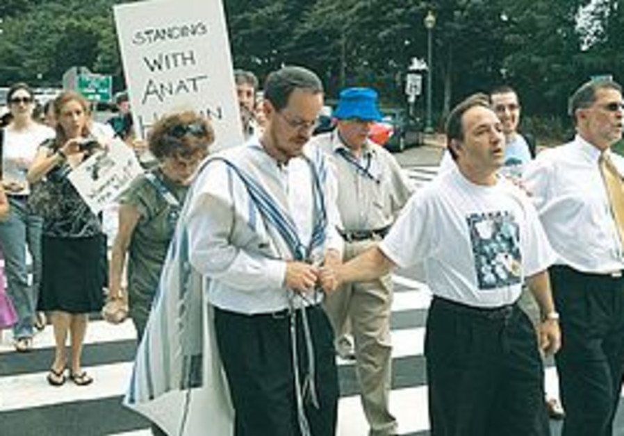 DEMONSTRATORS STAND outside the Israeli Embassy in Washington yesterday to protest the arrest of Ana