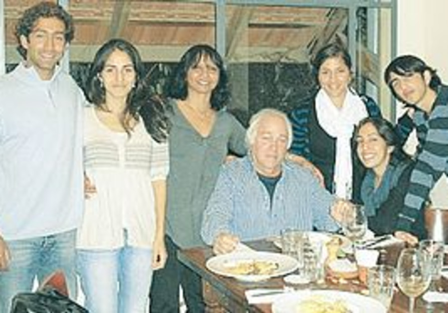 JAY AIZEN with his wife and five of his six children, at his 65th birthday party. Now he is 'not a v