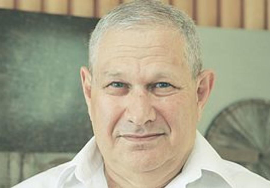 BANK LEUMI directors meet yesterday to elect David Brodet (below) their new chairman, replacing Eita