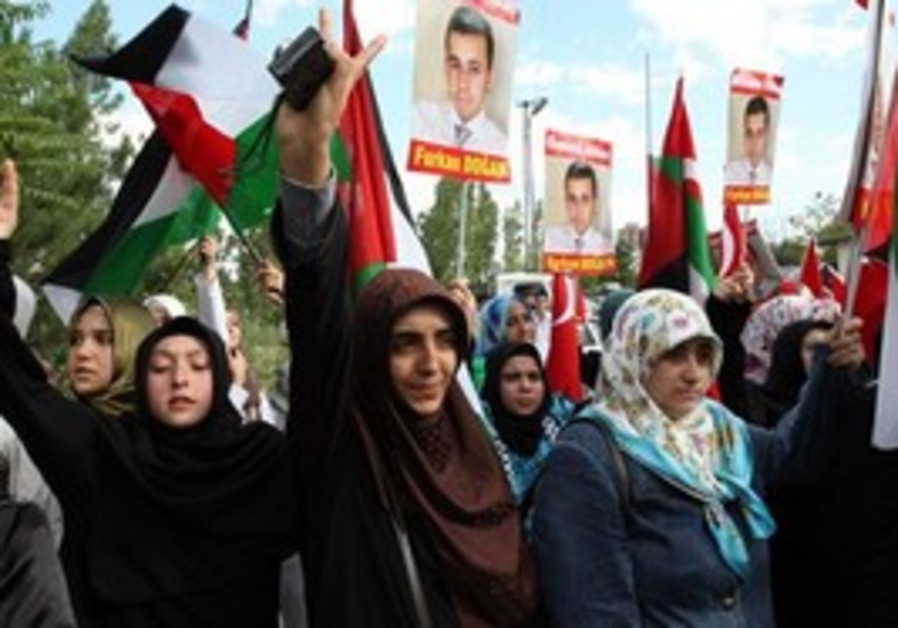 Pro-Palestinian Turks demonstrate at a security line before clashes with riot police as Israeli voll