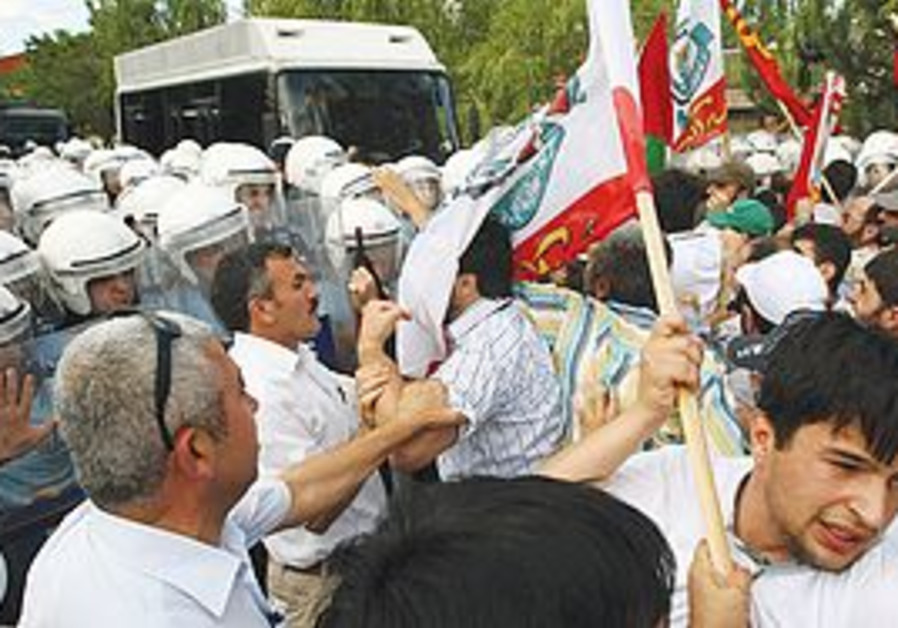 PRO-PALESTINIAN TURKS clash with riot police as the Israeli women's volleyball team played against S