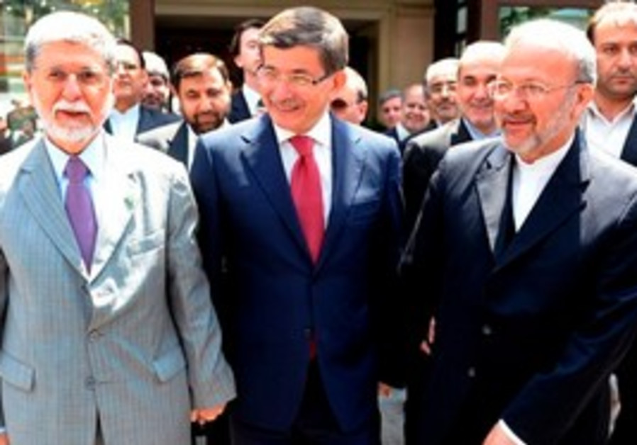 Turkish Foreign Minister Ahmet Davutoglu, center, talks to the media with his Brazilian counterpart